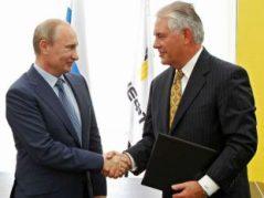 ExxonMobil CEO Rex Tillerson and Russian president Vladimir Putin